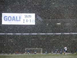 Tottenham won in snowy conditions. AFP