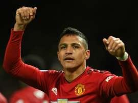 Alexis Sanchez celebrates Manchester United. AFP