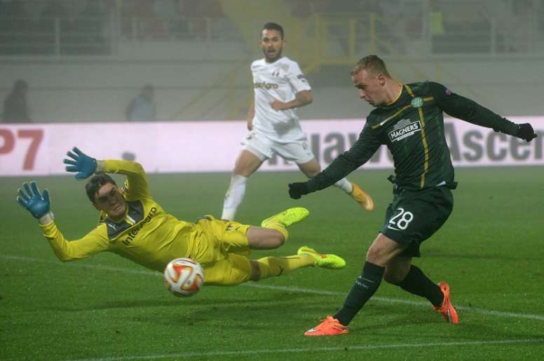 Leigh Griffiths (R) scored the first goal for Celtic after the champions were awarded a penalty four minutes into the match against Ross County, as the new season of the Scottish Premiership got underway