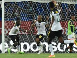 Ghana forward Andre Ayew (no. 10) celebrates with team-mates after scoring. AFP