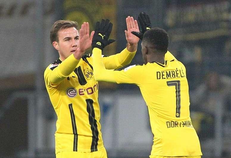 Dortmunds midfielder Mario Goetze celebrates scoring the 1-1 with Dortmunds midfielder Ousmane Dembele during the Bundesliga football match against Hoffenheim December 16, 2016