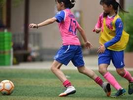 China women's football scraping the barrel. AFP