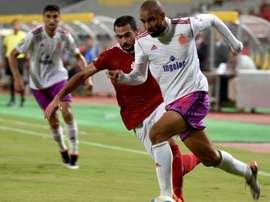 Al-Ahlys Ahmed Fathi (L) marks Wydads Ismail El Haddad during their CAF Champions League match. AFP