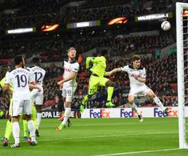 Harry Kane (C) watches as his defensive header goes into his own goal