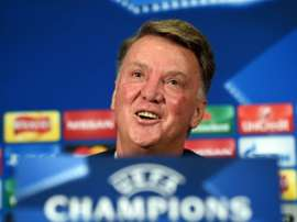 Manchester Uniteds Dutch manager Louis van Gaal smiles during a press conference at Old Trafford in Manchester, England on September 29, 2015 ahead of their UEFA Champions League football match against Wolfsburg on September 30