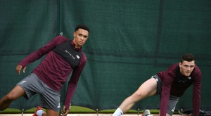 Liverpool defenders Alexander-Arnold and Robertson got to 24 assists between them last season. AFP