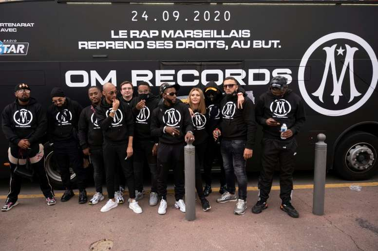 Rap artists from Marseille pose in front of a bus. afp_en