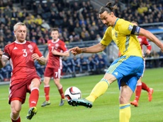 Kjaer (L) says the throat grabbing incident with Ibra has been forgotten. AFP