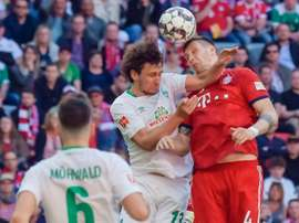 Sule (r) got the only goal in the victory over Bremen. AFP
