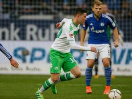 Wolfsburgs midfielder Julian Draxler (L) playing against FC Schalke, a game his team went on to lose, prompting fans to boo them