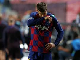 Piqué says Barcelona have hit rock bottom. AFP