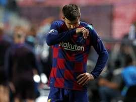 Piqué says Barcelona have hit rock bottom. AFP