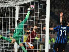 Inter Milan goalkeeper Samir Handanovic (L) pulls off a save during the Italian Serie A match against AS Roma