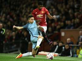 Maffeo (L) in action for Man City against Man Utd in the EFL Cup. AFP