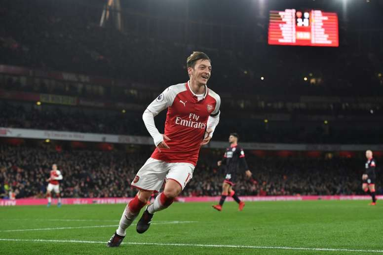 Ozil celebrates his goal against Huddersfield at the Emirates. AFP