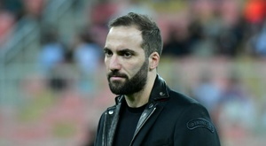 Higuain is reportedly edging closer to the Premier League. AFP