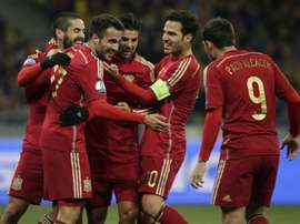 Spains players celebrate after scoring during the Euro 2016 qualifying football match against Ukraine at Olympiysky stadium in Kiev on October 12, 2015
