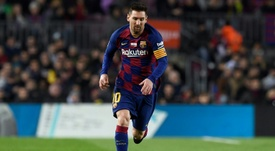 Lionel Messi always scores in a Barca coach's first game. AFP