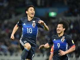Japan forward Shinji Kagawa (left) celebrates a goal against Syria in Saitama on March 29, 2016