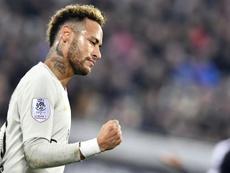 Neymar celebrates scoring his 11th league goal of the season against Bordeaux. AFP