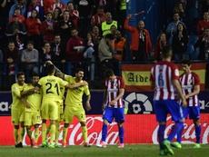 Villarreals players celebrate after midfielder Roberto Soriano scored