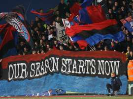 Crystal Palace fans hold a banner during aPremier League football match at Selhurst Park. BeSoccer