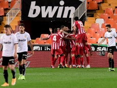 Atletico Madrid beat Valencia in La Liga thanks to an own goal. AFP