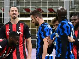 Zlatan Ibrahimovic (L) argues with Romelu Lukaku (R) during their Italian Cup clash. AFP