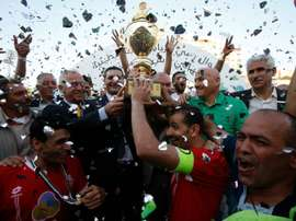 Players of Hebrons Ahly al-Khalil football club celebrate with the Palestinian Cup. AFP