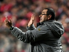 Napolis coach Maurizio Sarri gestures from the sideline during the UEFA Champions League Group B football match SL Benfica vs SSC Napoli at the Luz stadium in Lisbon, on December 6, 2016