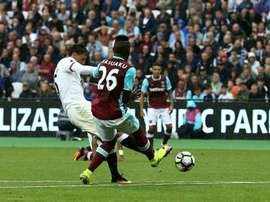 Watfords midfielder José Holebas (L) scores his teams fourth goal during the English Premier League football match against West Ham United on September 10, 2016