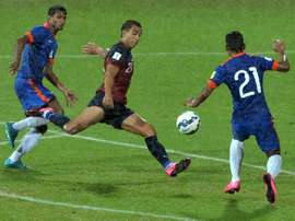 Guam forward Marcus Lopez is challenged by Indias Narayan Das (right) and Arnab Kumar Mondal during their Asia Group D 2018 World Cup qualifying match in Bangalore on November 12, 2015
