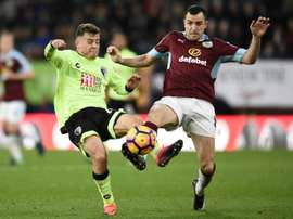 Burnley's Dean Marney (right) in action during a match against Bournemouth. AFP