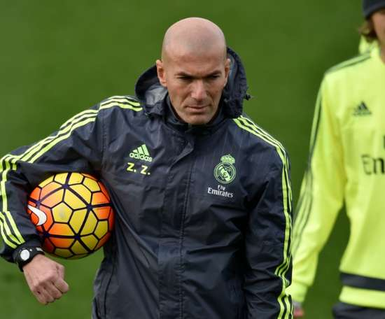 Real Madrids new French coach Zinedine Zidane holds a ball during a training session at the at Valdebebas training ground in Madrid on January 8, 2016