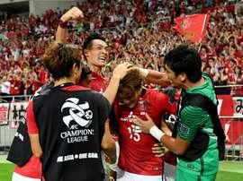 Forward Toshiyuki Takagi celebrates after scoring. AFP