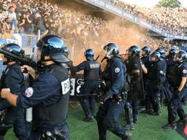 Fans stormed the pitch. AFP