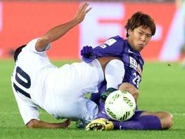 Sanfrecce Hiroshimas Takuya Marutani (right) battles for the ball with Auckland City forward Ryan de Vries during their FIFA Club World Cup match in Yokohama, Japan, on December 10, 2015