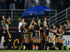Bolivian team The Strongest celebrate a goal scored by Matias Alonso during their 2016 Copa Libertadores match against Sao Paulo held at Pacaembu stadium on February 17, 2016