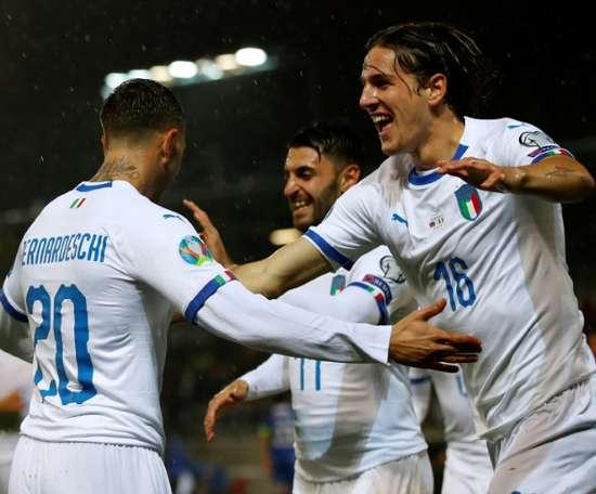Bernardeschi (L) opened the scoring for Italy in rout of Liechtenstein. AFP