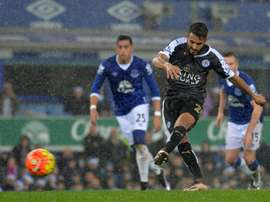 Leicester Citys midfielder Riyad Mahrez scores their second goal from the penalty spot during the English Premier League football match between Everton and Leicester City at Goodison Park in Liverpool, north west England on December 19, 2015