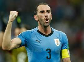 Godín dio caza a Pereira y entró en la historia de Uruguay. AFP