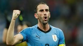 La Juventus piensa en pagar la cláusula de Godín. AFP