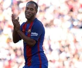 Ronaldinho gifted his boots to Rodrigues. AFP