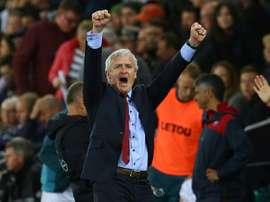 Hughes celebrates a victory against Swansea City last season. AFP