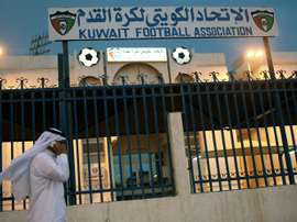 A man walks past the Kuwaiti Football Association (KFA)s headquarters on October 17, 2015, in Kuwait City