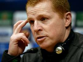 Neil Lennon was struck by objects thrown by the crowd. AFP