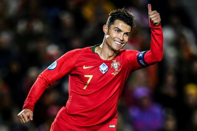 Ronaldo hat-trick fires Portugal to brink of Euro 2020 qualification. AFP