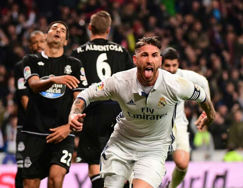 Real Madrids captain Sergio Ramos celebrates after scoring a goal during their Spanish La Liga match against Deportivo la Coruna, at the Santiago Bernabeu stadium in Madrid, on December 10, 2016