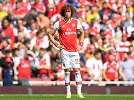 David Luiz teria que reduzir seu salário para voltar ao Benfica. AFP