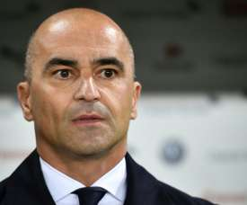 Roberto Martinez will apparently stay on until at least the 2022 World Cup. AFP